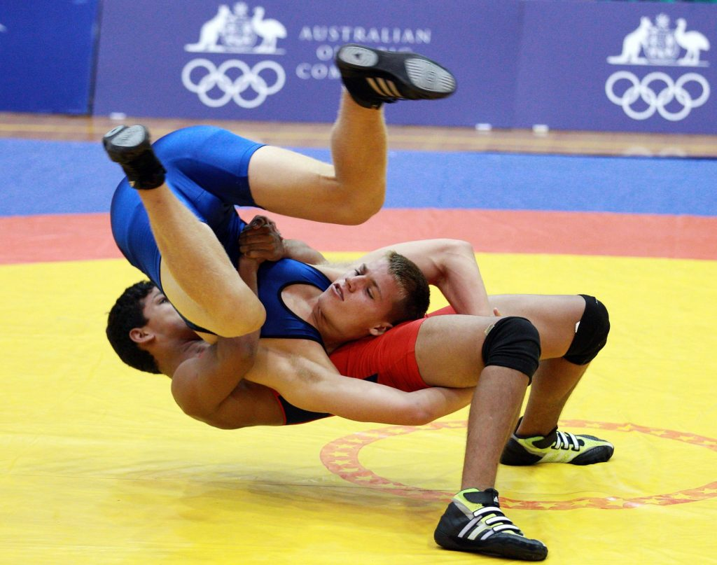 SYDNEY, AUSTRALIA - JANUARY 20: Guilherme Dias of Brazil (red) competes against Sean Odea of Australia during the Freestyle 85 kg Wrestling event in the Sports Halls at Sydney Olympic Park Sports Centre on January 20, 2013 in Sydney, Australia. (Photo by Craig Golding/Getty Images)